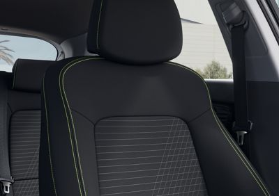 Close-up of the all-new Hyundai i20's driver's seat, Lime Green colour scheme
