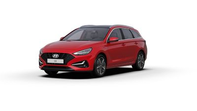 Front side view of the new Hyundai i30 Wagon in the colour Engine Red.